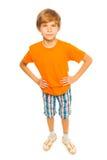 Boy in orange shirt Stock Photo