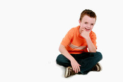 Boy in orange shirt smiling Stock Photography