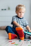 Boy with orange socks Royalty Free Stock Image