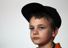 Boy with orange t-shirt Stock Images