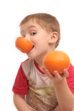 The boy with oranges Stock Photography