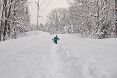 Boy out in a snow storm Stock Photo