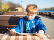 Boy in outdoor restaurant Royalty Free Stock Images