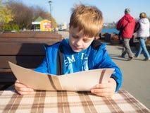 Boy in outdoor restaurant Stock Images