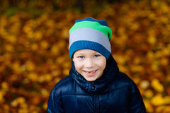 Boy outdoors in the park in autumn. Happy boy outdoors in a park in autumn stock photography