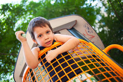 Boy in outdoors playground Royalty Free Stock Images