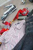 Boy outfit near set of car toy. Striped shirt, denim pants  yellow and red cars. Close up. Stock Photography