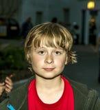 Boy outside at night Stock Image