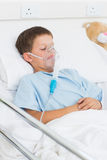 Boy with oxygen mask in hospital ward Royalty Free Stock Images