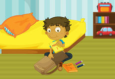 Boy packing his bag Stock Images