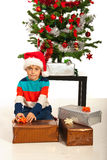 Boy packs Christmas presents Royalty Free Stock Photos
