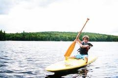 Boy paddle boarding Stock Image