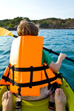 Boy paddling in a canoe at Royalty Free Stock Photo