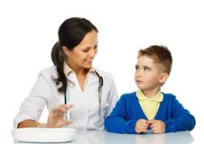 Boy at paediatrician office Stock Images