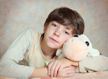 Boy in pagama with his sheep toy Royalty Free Stock Image
