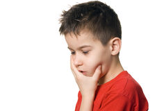 Boy in pain. Having a toothache- isolated Stock Images