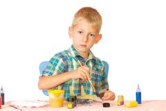 Boy paint airplane model Stock Photos