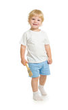 Boy with paint brush front view standing full length Stock Photo