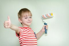Boy with a paint roller and a thumb up Stock Photography