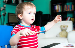 Boy with paintbrush. Baby boy with his paintbrush Stock Image