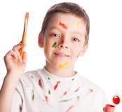 Boy with paintbrush Stock Photo