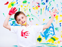 Boy painted. Portrait of a preschool boy waving his hands painted in red Stock Photo