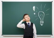 Boy with painted bulb having idea Stock Photos