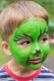 Boy with painted face Royalty Free Stock Image