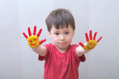 Boy with painted hands Stock Photo