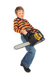 Boy painted for holiday with chainsaw Royalty Free Stock Images
