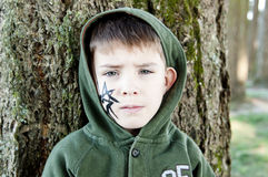 Boy with a painted spider on Halloween Royalty Free Stock Image