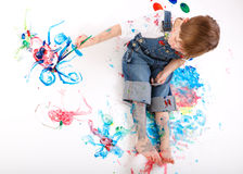 Boy painting. Cute 5 years old boy painting on white background stock images