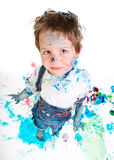 Boy painting. Funny photo of cute 5 years old boy painting on white background stock photo