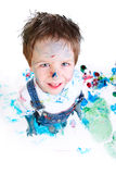Boy painting. Funny photo of cute 5 years old boy painting on white background royalty free stock photos