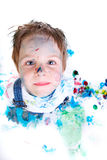 Boy painting. Funny photo of cute 5 years old boy painting on white background stock photography