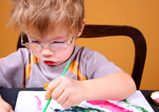 Boy painting. Little boy painting at easel Stock Photos