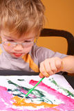 Boy painting. Little boy painting at easel Royalty Free Stock Photo
