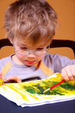 Boy painting. Little boy painting at easel Royalty Free Stock Images