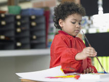 Boy Painting In Art Class Royalty Free Stock Photos