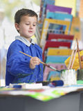 Boy Painting In Art Class Stock Images
