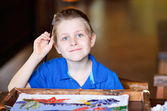 Boy painting a batik Royalty Free Stock Photography