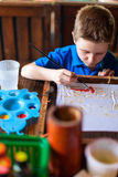 Boy painting a batik Stock Photo
