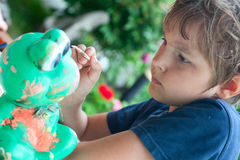 Boy painting with a brush Stock Photo