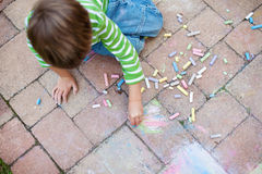 Boy Painting with chalk Royalty Free Stock Image
