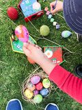 Boy is painting Colorful Easter egg and green grass Stock Photography