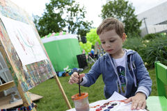 Boy painting at easel Royalty Free Stock Images