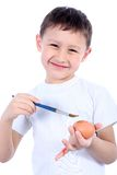 Boy Painting Easter Egg Stock Photos