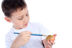 Boy painting easter egg Stock Images