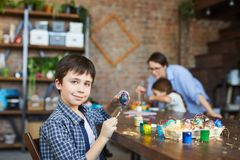Boy Painting Easter Eggs stock image