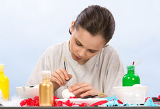 Boy painting egg royalty free stock image